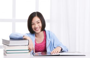 young girl studying with white background